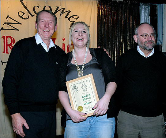 PotY presentation to Paul Andrews and Louisa on stage at the Red Lion